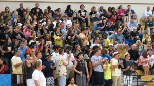 The Gold crew cheers on the Volleyball team. The crew followed the team on their run to the State Quarterfinals