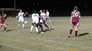 Senior Alexis Bredeau (left #1), freshman Danielle Darius (middle #20), and junior Danielle Eule (right #11) fight for a ball against Wiregrass Ranch. Bredeau and Eule were both members of the Lady Warriors state championship team in 2011.