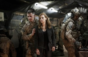 Jessica Chastain looks on as SEAL Team Six brings back the body of Osama bin Laden.