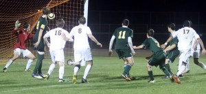 Senior Derek Gebhard watches his winning goal go in. It was his sixth goal in the state tournament.