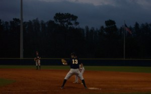 Warrior Chase Turner holds a runner on first as pitcher Gideon Dunn focuses on the batter. The Warriors traveled to Brandon High School the next day to claim another victory of 4-1.
