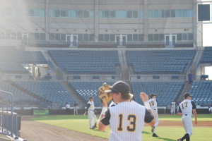 The Warriors warm up in George M Steinbrenner field  before the game. They also played a game there last season.
