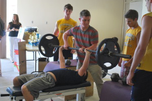 Sophomore Zamir Ode prepares to use the bench press. The contest outside the lunchroom was to promote the Warrior Body Fitness show.
